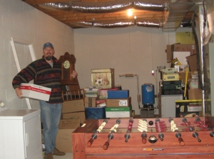 "Mark standing with some of his ""stuff."""