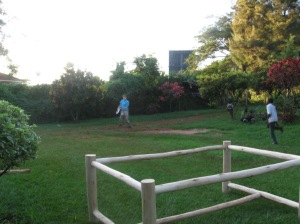 Joshua and Timothy throw Frisbee and football with each other.  The frame in the foreground is a table being built for the house where we are staying