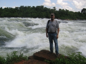 I'm standing at Bujagali Falls on the Nile River, just a few miles north of the Nile's source, Lake Victoria.
